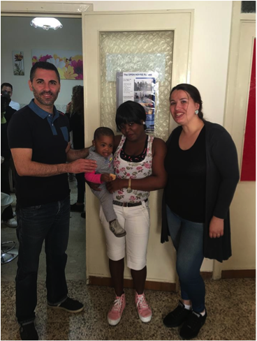 YWAMers in Sicily with Refugee Mom with Baby Born Aboard A Ship