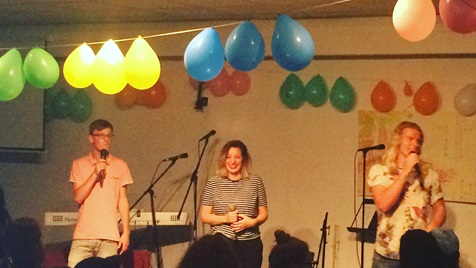 Party with balloons and people singing on front of a group at YWAM Amsterdam