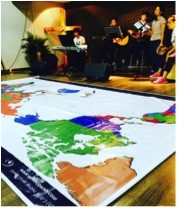 YWAM Hong Kong Praying for Refugees over a large world map
