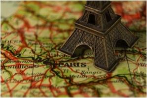 Map of France with Mini-Eiffel Tower sitting over Paris