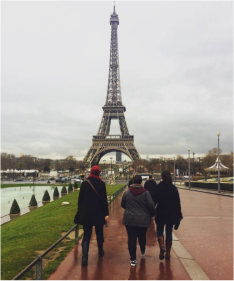 Three YWAMers walking towards the Eiffel Tower along the river in Paris